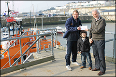 Lifboat coxswain Ian Cannon receiving our cheque