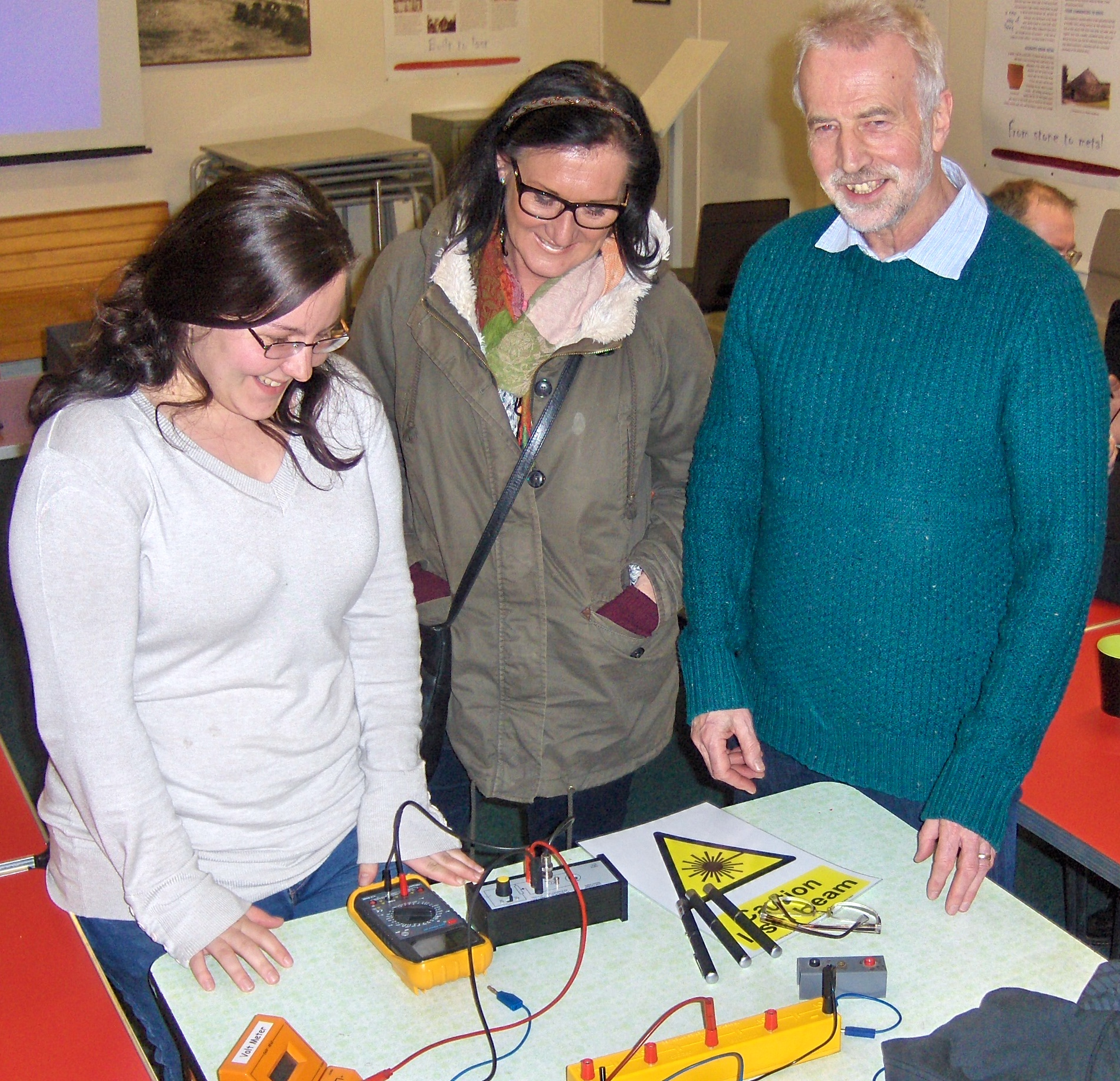 Kaz, Lyne and John looking at the photoelectric effect